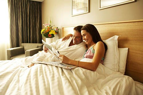 man-and-woman-in-guest-room